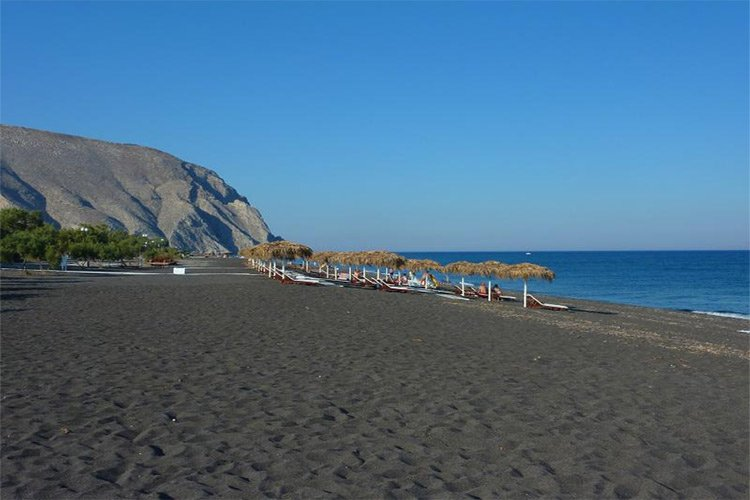 perivolos black beach in santorini island greece