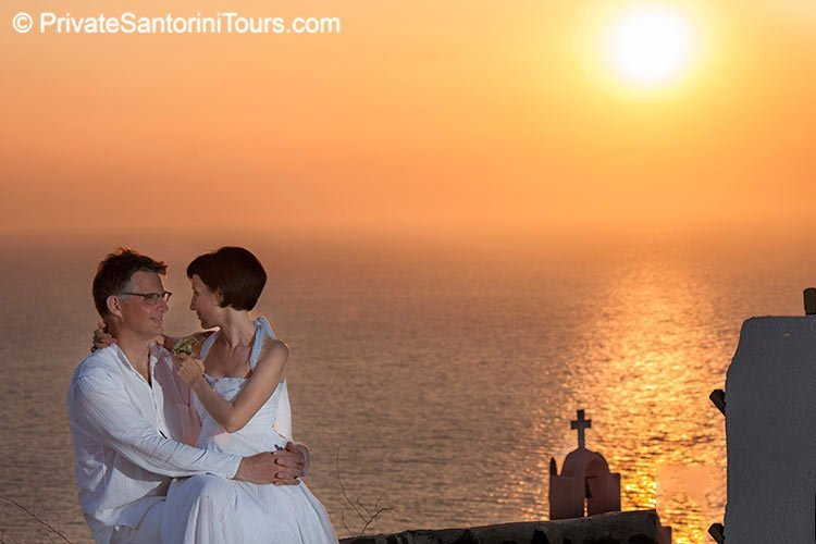 romantic portait during oia sunset
